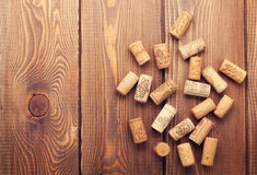 Wine corks over rustic wooden table background Royalty Free Stock Photos