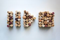 Wine corks pause, play and stop button shapes. Isolated on white background from a high angle view royalty free stock photo