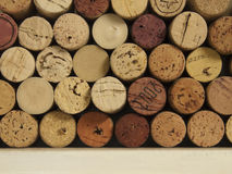 Wine corks on a shelf. A variety of used wine corks on a shelf Stock Photo