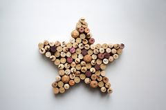 Wine corks star shaped composition from above. Wine corks star shaped composition isolated on white from a high angle view royalty free stock photos