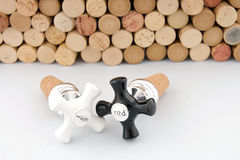Wine corks and stoppers. Red and white wine bottle stoppers with corks in background Stock Photo
