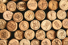 Wine corks tops. Brown wine corks tops with dates on, may serve as a background Stock Image