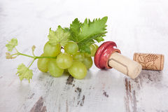 Wine corks, white grapes and wine leaves. Royalty Free Stock Photo
