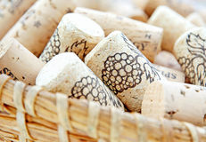 Wine corks in wicker basket Royalty Free Stock Photos