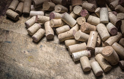 Wine corks on wooden table Royalty Free Stock Images