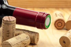 Wine and corks on wooden table. French red wine and corks Stock Image