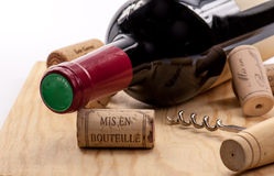 Wine and corks on wooden table. French red wine and corks Royalty Free Stock Image