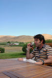 Wine Country 2. A man enjoys a glass of red wine in a hilly outdoor wine country setting Royalty Free Stock Photos