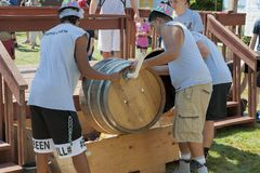 Wine Crush Harvest Festival in Carlton Oregon. Carlton, Oregon,USA - September 12, 2015:Members of the Crush Crew dump the crushed grapes from the barrels at stock photo