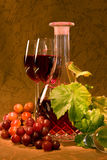 Wine in crystal goblet. Crystal goblet with red wine and grapes Stock Photo