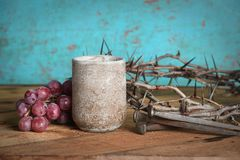 Wine Cup, Grapes, Nails and Crown of Thorns. Communion table with crown of thorns, wine cup, grapes and nails stock images