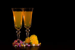 Wine from dandelions in glasses. Black background. Stock Photos