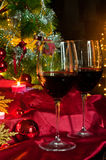 Wine and decorations for Christmas. Christmas time: stars, lights, decorations, candles and a glass of good wine to warm armosfera of Christmas Stock Photos