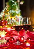 Wine and decorations for Christmas. Christmas time: stars, lights, decorations, candles and a glass of good wine to warm armosfera of Christmas Stock Photography