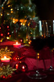 Wine and decorations for Christmas. Christmas time: stars, lights, decorations, candles and a glass of good wine to warm armosfera of Christmas Stock Photo