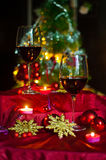 Wine and decorations for Christmas. Christmas time: stars, lights, decorations, candles and a glass of good wine to warm armosfera of Christmas Stock Image