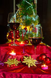Wine and decorations for Christmas. Christmas time: stars, lights, decorations, candles and a glass of good wine to warm armosfera of Christmas Royalty Free Stock Images
