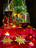 Wine and decorations for Christmas. Christmas time: stars, lights, decorations, candles and a glass of good wine to warm armosfera of Christmas Royalty Free Stock Photo