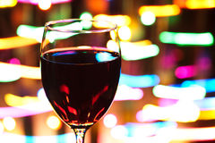 Wine and Defocused Lights Royalty Free Stock Photos