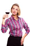 Wine degustator. Blond girl holding a glass of red wine Stock Images