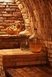 Wine demijohn in cellar. Wine demijohn inside wine cellar Stock Photos