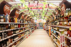 Alcohol store. A big alcohol store with huge collection of alcohols, wines or other drinks in supermarket Stock Photo