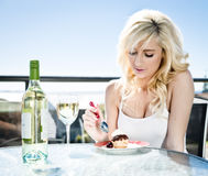 Wine and dessert in cafe Royalty Free Stock Photography