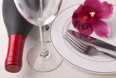 Wine and dishware Stock Image