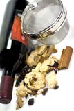 Wine, dried fruits, spices and metal strainer Royalty Free Stock Photo