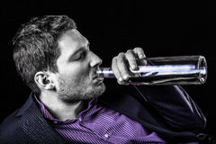 Wine drinking from the bottle Royalty Free Stock Photography