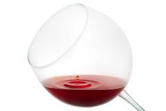 Wine drop splashing on glass Stock Image