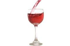 Wine e un versamento di vetro, fondo bianco Fotografie Stock Libere da Diritti