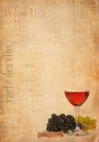 Wine en vidrio y fruta en viejo fondo de papel Fotos de archivo