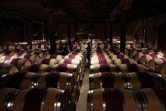 Wine enthusiasts in The Hess Collection Winery cellar during wine tasting tour in Napa, California Stock Photo