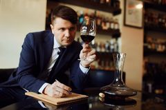 Wine expert working in the restaurant. Creation of wine list stock photography