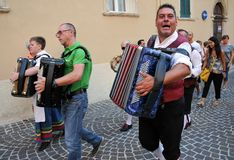 Wine festival in the medieval village of Staffolo in central Ita. 19 August 2018, Event Wine festival: musicians and people with traditional clothes in the stock photography
