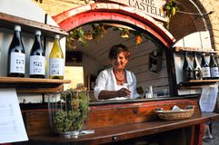Wine festival in the medieval village of Staffolo in central Ita. 19 August 2018, Event Wine festival: sellers of Verdicchio wine, typical of the area in the stock image