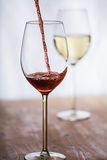 Wine filled into a glass Royalty Free Stock Photos
