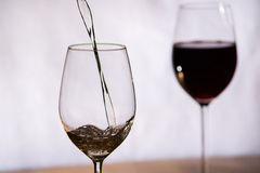 Wine filled into a glass. Wine gets filled into a glass royalty free stock photo