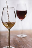 Wine filled into a glass. Wine gets filled into a glass royalty free stock images