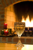 Wine by the fire Stock Photography