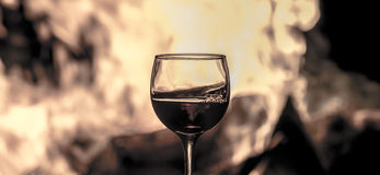 Wine and fire Royalty Free Stock Photo