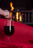 Wine and fireplace Stock Photography