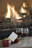 Wine by the fireplace Stock Photo