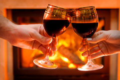 Wine by the fireplace, glasses of wine. Royalty Free Stock Images
