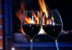 Wine by the fireplace Royalty Free Stock Photo