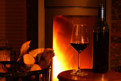 Wine at fireplace. Wine at warm and cozy fireplace Royalty Free Stock Image