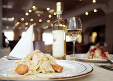 Wine, fish, pasta Royalty Free Stock Images