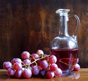 Wine flagon. Still life with grapes and wine flagon Stock Photos