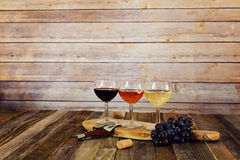 Wine flight with grapes, cork and bottle opener Stock Photos